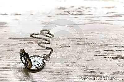 Vintage Pocket Watch on Old Aged Wood Background