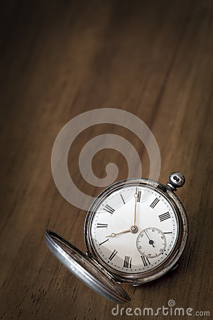 Vintage Pocket Watch over Grunge Timber