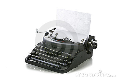 Vintage portable typewriter with paper
