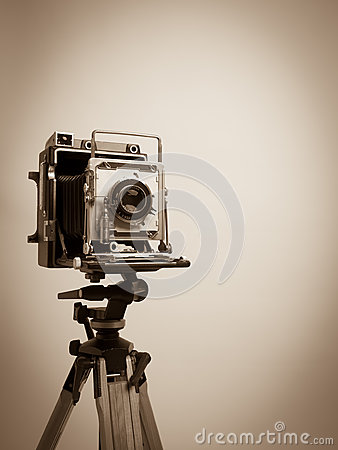 Vintage Press Camera on Wooden Tripod