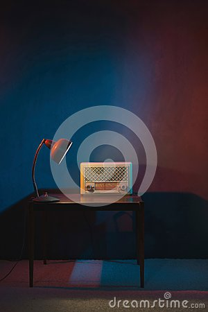 Free Vintage Radio In Evening Interior Lit By Desk Lamp. Royalty Free Stock Photos - 109660538
