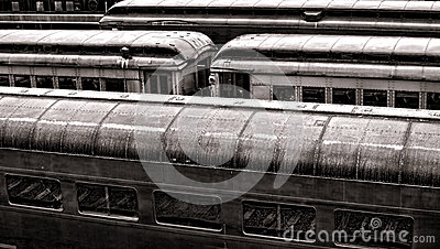 Vintage Rail Passenger Cars in Old Train Station