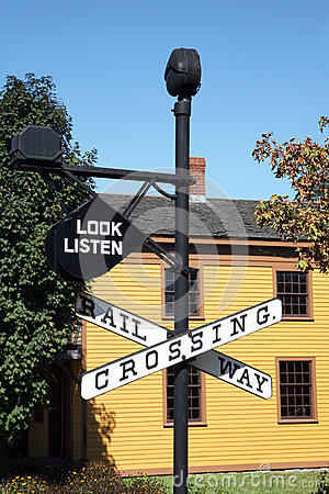 Free Vintage Railroad Crossing Sign With Building In Background Stock Photos - 52834873