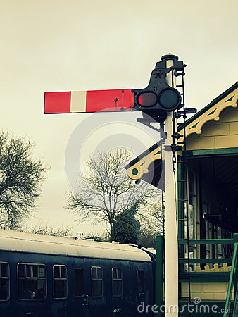 Free Vintage Railway Stop Signal With Signal Box And Train In The Background Stock Photography - 62816612