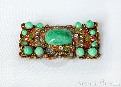 Vintage rectangular brooch with green stones
