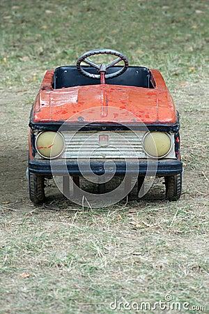 Vintage red pedal car