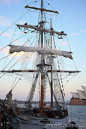 Furl the sails on sailing ship at dusk Editorial Stock Photo