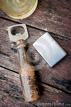 Free Vintage Silver Lighter Bottle Opener And Glass Of Whiskey On Tab Stock Photo - 104527850