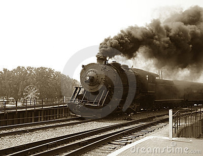 Vintage Steam Engine Locomotive and Train Speeding