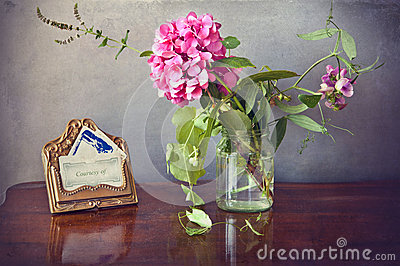 Vintage stilllife, a hydrangea in vase and a card brass holder