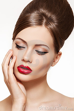 Vintage style model. Lips make-up, shiny hairstyle