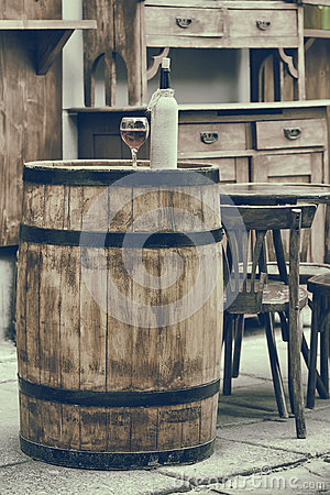 Free Vintage Stylized Photo Of Wooden Barrel With Bottles Of Wine Royalty Free Stock Photos - 37710958