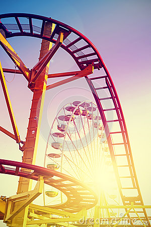 Free Vintage Stylized Roller Coaster In Amusement Park. Stock Image - 56415621