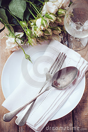 Vintage table setting with roses