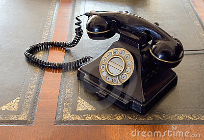 Vintage telephone on desk.