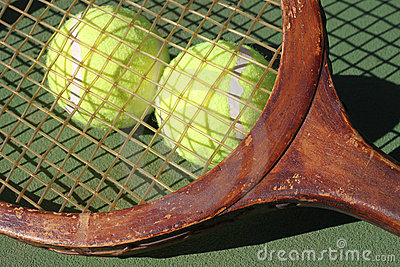 Vintage Tennis Racquet and Balls Closeup