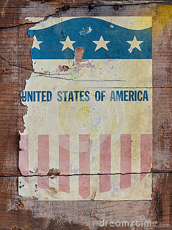 Vintage torn seal of the USA on wood