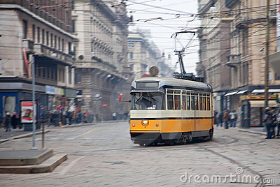 Vintage tram on the city street with motion blur