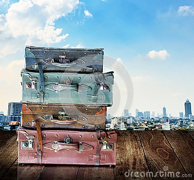 Vintage travel luggage on wooden