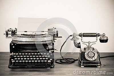 Vintage typewriter and telephone