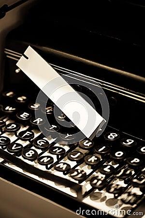Vintage typewriter and white tag