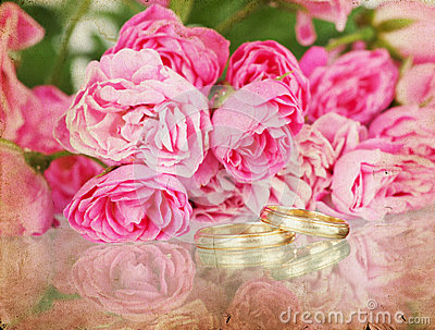 Vintage wedding background with flowers and rings