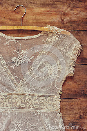 Free Vintage White Crochet Lace Top With Hanger On Wooden Background Royalty Free Stock Photography - 57361207