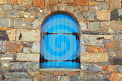 Vintage window with blue shutters,Greece.