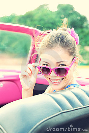 Vintage woman in retro car
