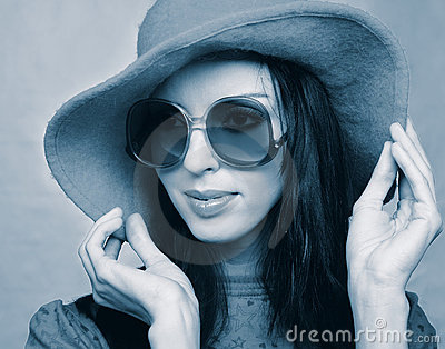 Vintage woman in sunglasses and  hat
