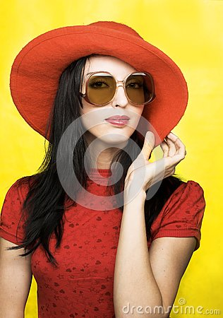 Vintage woman in sunglasses and red hat
