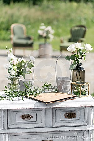 Free Vintage Wood Chairs And Table With Flower Decoration In Garden. Outdoor Stock Images - 113328174