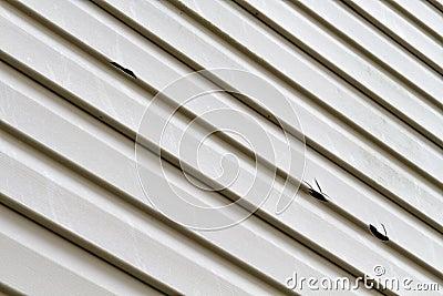 Vinyl siding panel damaged by hail storm stock images for Hail damage vinyl siding