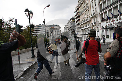 Violent clashes during Merkel visit in Athens Editorial Stock Image