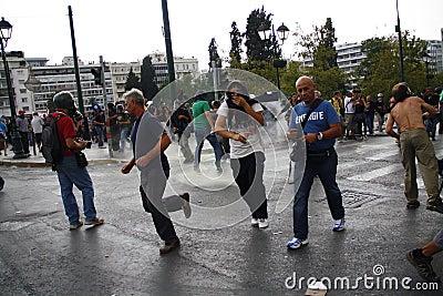 Violent clashes during Merkel visit in Athens Editorial Image