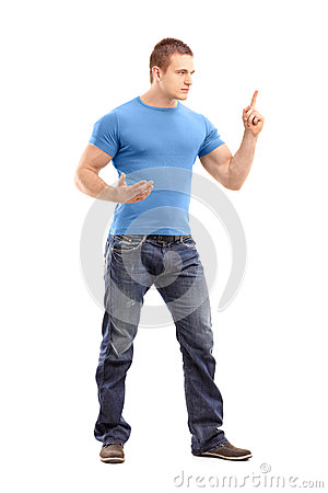 Violent young man threatening with finger