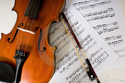 A violin and bow on sheet music