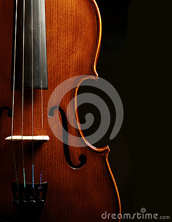 Violin close up against black