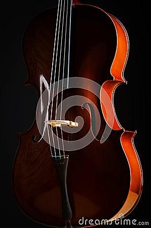 Violin in dark room