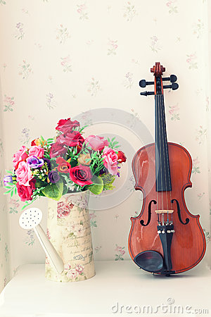 Violin and flower bouquet in living rooem