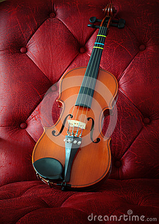 Violin on luxury red leather