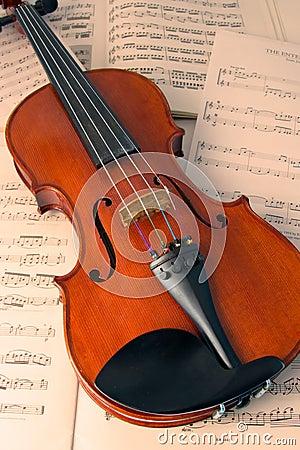 Violin over music scores