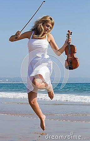 violinist jump on beach
