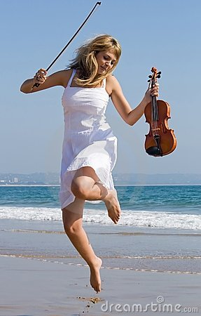 Free Violinist Jump On Beach Stock Photo - 7294470