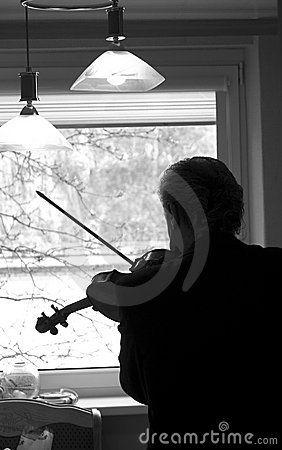 Violinist practicing at home