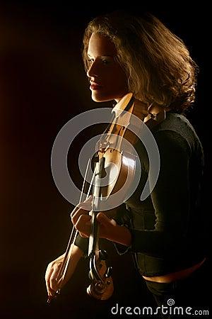 violinist violin playing on black