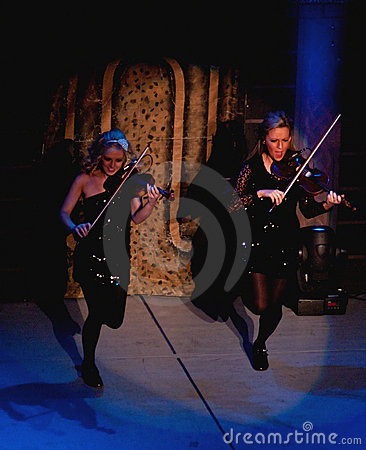 Violinists performing in lord of the dance Editorial Image
