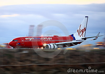 Virgin Blue Boeing 737 in motion on runway. Editorial Stock Image