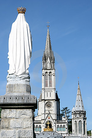 Virgin Mary and basilica in pilgrim town Lourdes