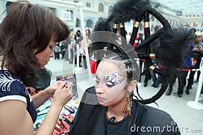 Visagiste makes makeup for model Editorial Photo